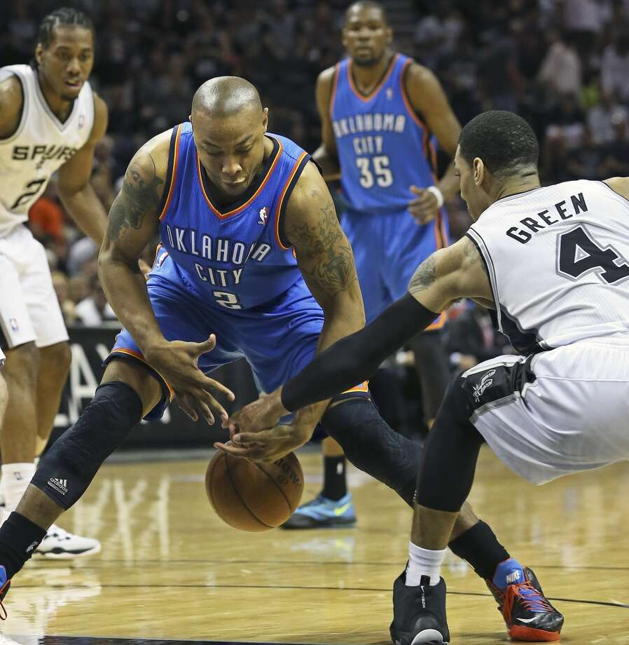 Danny Gren reaches in and gets steal from Caron Butler in the second half as the San Antonio Spurs play the Oklahoma City Thunder in game 2 of the Western Conference Finals at the AT&T Center on May 21, 2014. (Tom Reel/Express-News) Photo: TOM REEL