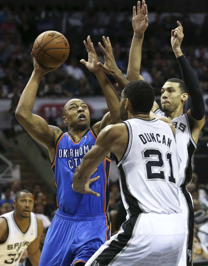 Caron Butler tries a shot underneath against Tim Duncan as the San Antonio Spurs play the Oklahoma City Thunder in game 2 of the Western Conference Finals at the AT&T Center on May 21, 2014. (Tom Reel/Express-News) Photo: TOM REEL
