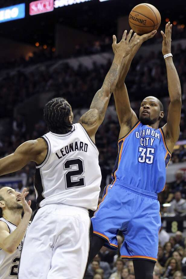 Oklahoma City Thunder's Kevin Durant shoots over San Antonio Spurs' Manu Ginobili and Kawhi Leonard during first half action of Game 2 in the Western Conference Finals Wednesday May 21, 2014 at the AT&T Center. (Edward A. Ornelas/Express-News) Photo: Edward A. Ornelas, San Antonio Express-News