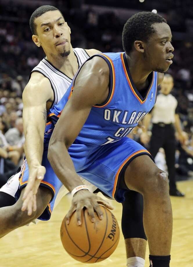 San Antonio Spurs' Danny Green defends Oklahoma City Thunder's Reggie Jackson during first half action of Game 2 in the Western Conference Finals Wednesday May 21, 2014 at the AT&T Center. (Edward A. Ornelas/Express-News) Photo: Edward A. Ornelas, San Antonio Express-News