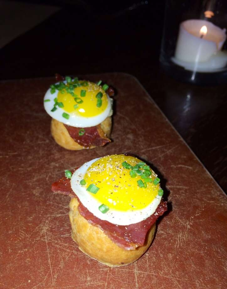 Croque Monsieur gougeres with cheese, bacon and a fried quail egg