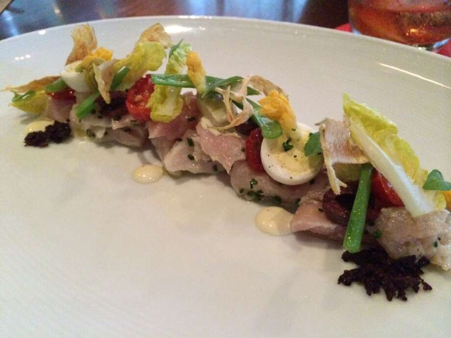 Nicoise salad with olive oil poached tuna, artichokes, olives and green beans ($17)