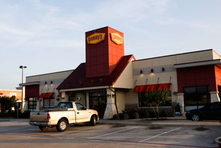 Five men, including at least two with guns, robbed a Denny's restaurant in the 9600 block of North Sam Houston Parkway about 3 a.m. Thursday. Witnesses say the suspects beat a deaf man who could not understand their demands. Photo: Cody Duty / Houston Chronicle