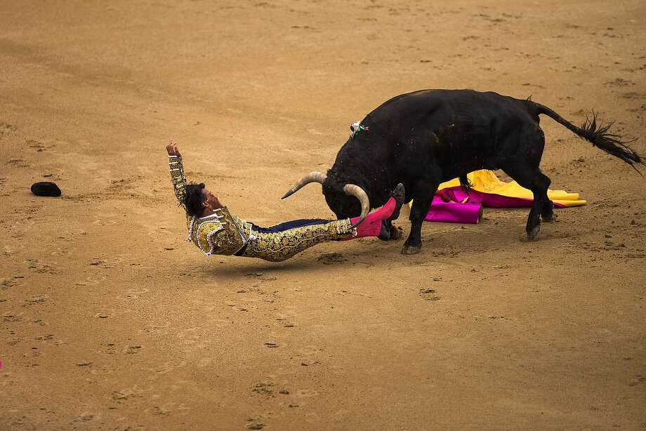 Spanish bullfighter David Mora is tossed by an El Ventorrillo ranch fighting bull during a bullfight at Las Ventas bullring in Madrid, Spain, Tuesday, May 20, 2014. Bullfighting is a traditional spectacle in Spain and the season runs from March to October. Photo: Andres Kudacki, Associated Press