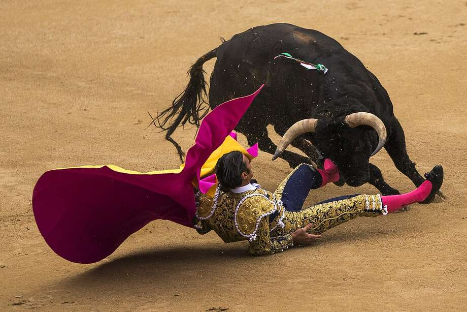 Spanish bullfighter David Mora is tossed by an El Ventorrillo ranch fighting bull during a bullfight at Las Ventas bullring in Madrid, Spain, Tuesday, May 20, 2014. Bullfighting is a tradition in Spain and the season runs from March to October.  Photo: Andres Kudacki, Associated Press