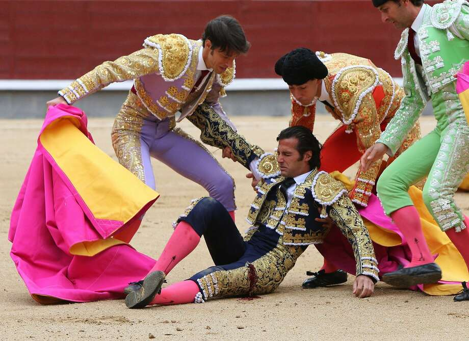 Assistants help Spanish matador David Mora after he was injured during a bullfight of the San Isidro Feria at the Las Ventas bullring in Madrid on May 20, 2014. Half-tonne fighting bulls skewered or trampled all three matadors in an extraordinary upset at Madrid's prestigious Las Ventas bullring, forcing the entire spectacle to be cancelled. Photo: Stringer, AFP/Getty Images