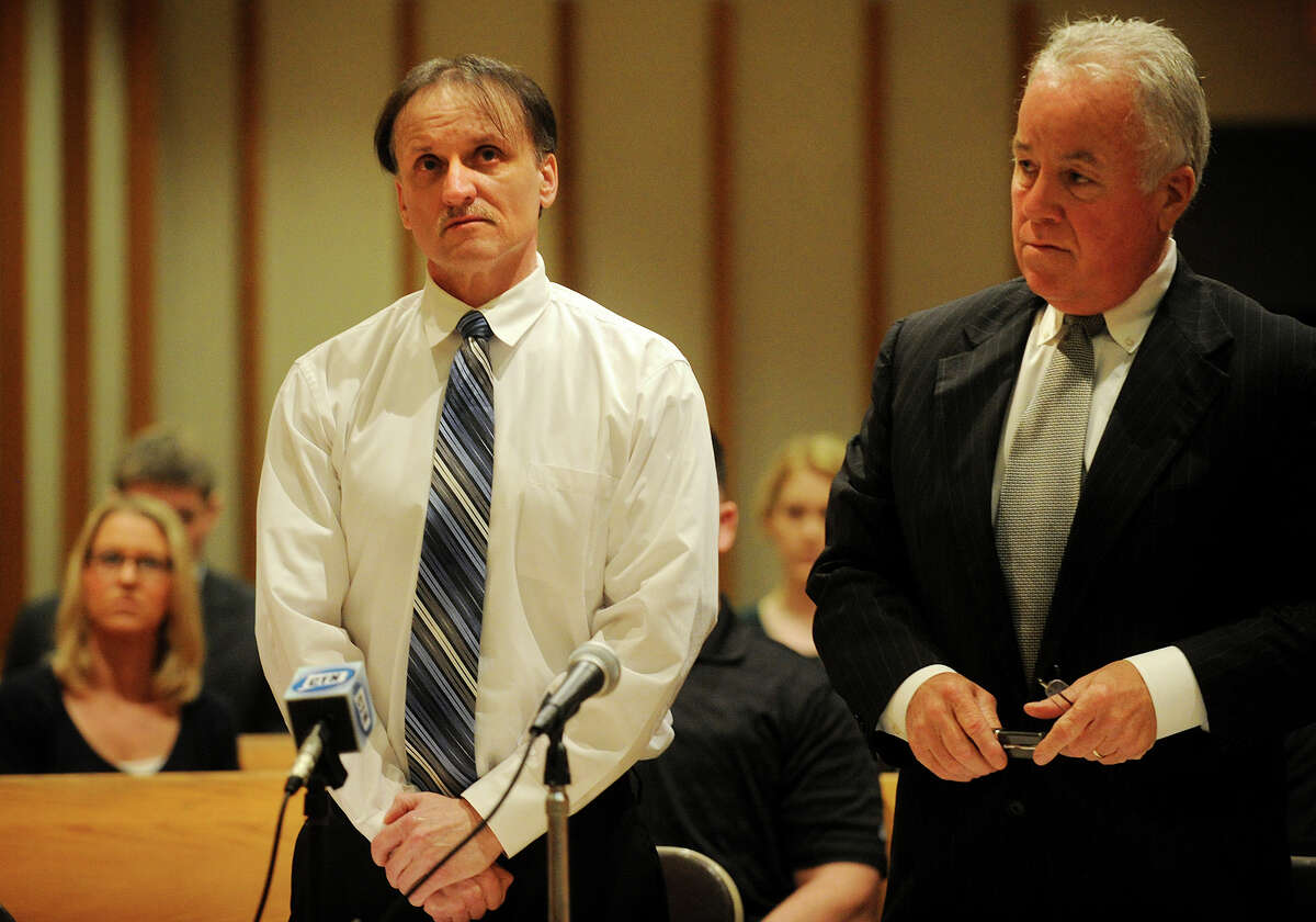 Richard Roszkowski, left, stands with his lawyer, Michael Courtney, as he receives his sentence of death by lethal injection for the 2006 Bridgeport murders of Thomas Gaudet, Holly Flannery, and nine-year-old Kylie Flannery, at the Superior Courthouse on Main Street in Bridgeport, Conn. on Thursday, May 22, 2014.