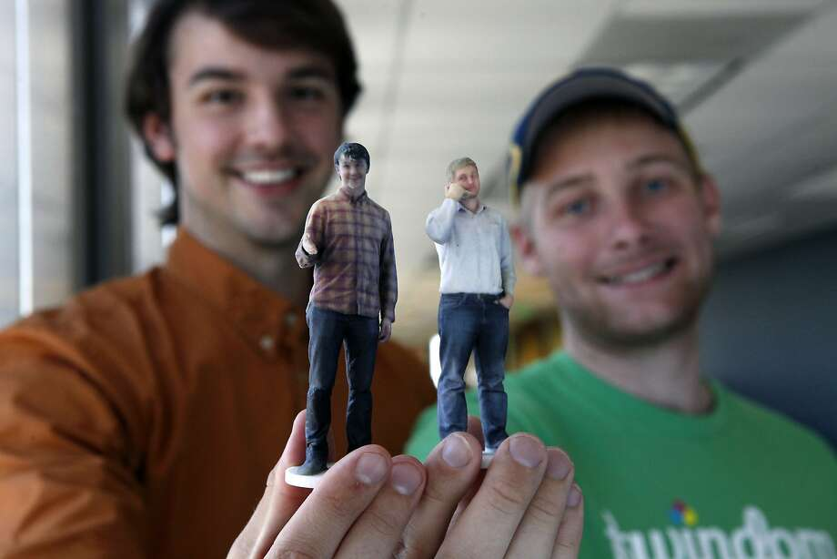 Twindom co-founders David Pastewka (left) and Will Drevno show 3-D printed figurines of themselves in their Berkeley office. Photo: Michael Short