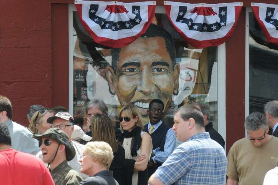 Visitors to Cooperstown gather in front of a picture depicting President Barack Obama. (Michael P. Farrell/Times Union)