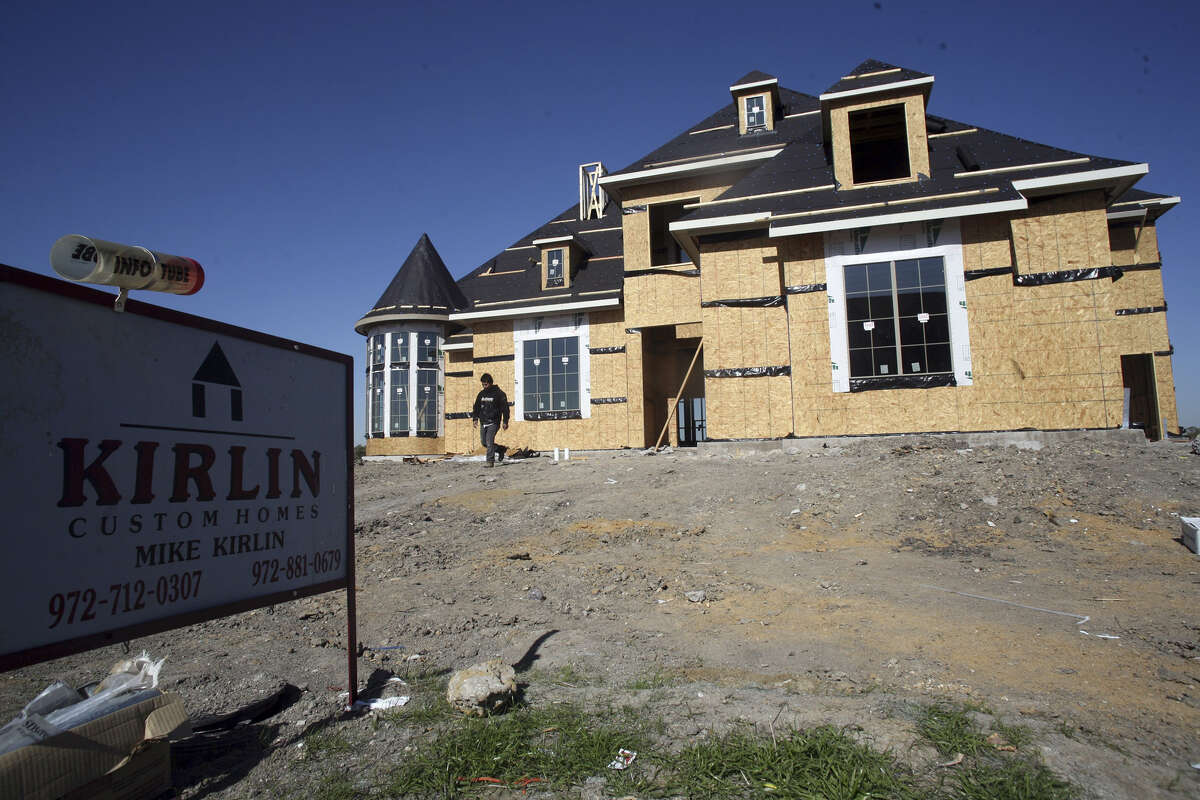 FRISCO, TEXAS - NOVEMBER 17: A new house is under construction in a new exurb of Dallas November 17, 2006 in Frisco, Texas. New home construction plunged 14.6 percent in October, the lowest level in more than seven years, according to a commerce department report released November 17, 2006. The slump in housing starts may signal that the worst is not over for the cooling residential property market. (Photo by Brian Harkin/Getty Images)