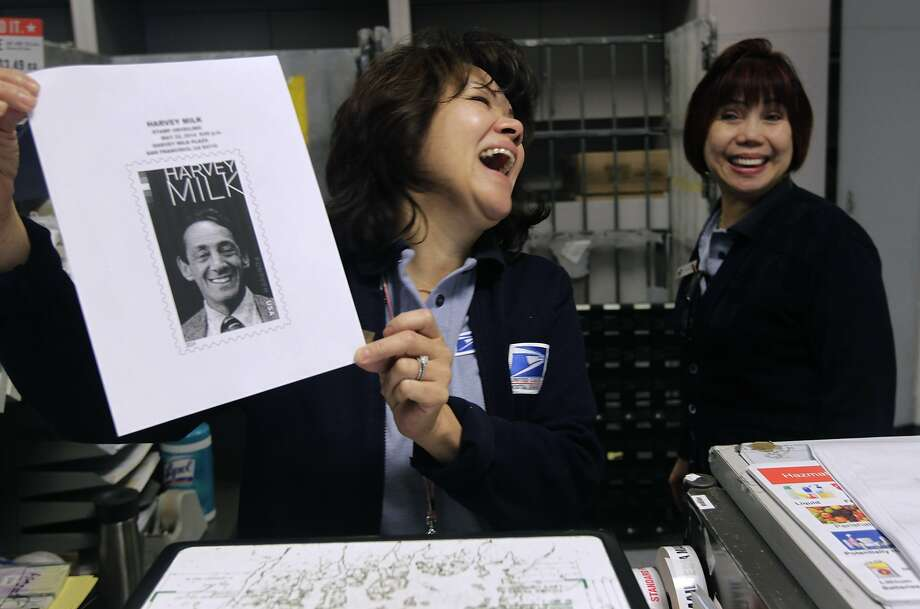"Workers Maggie Lu (left) and Yolanda Layoc show a copy of the Harvey Milk stamp in the Castro post office. ""It was just like when Elvis Presley (stamps) went on sale,"" Layoc said. Photo: Paul Chinn, The Chronicle"