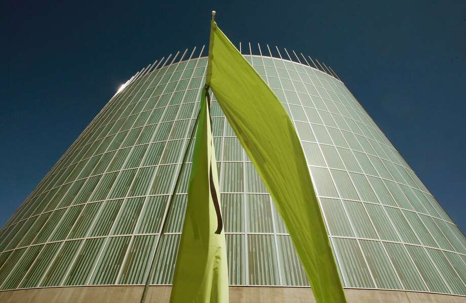 Flags fly in a soft breeze outside the Cathedral of  Christ the Light Thursday, Sept. 25, 2008. The Cathedral was dedicated in Oakland, Calif, as hundreds of parishioners joined priests from throughout the state and four attending cardinals for the ceremony. Photo: Lance Iversen, The Chronicle