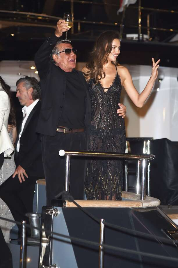 Roberto Cavalli (L) and Irina Shayk attend the Roberto Cavalli yacht party at the 67th Annual Cannes Film Festival on May 21, 2014 in Cannes, France. Photo: Venturelli, WireImage