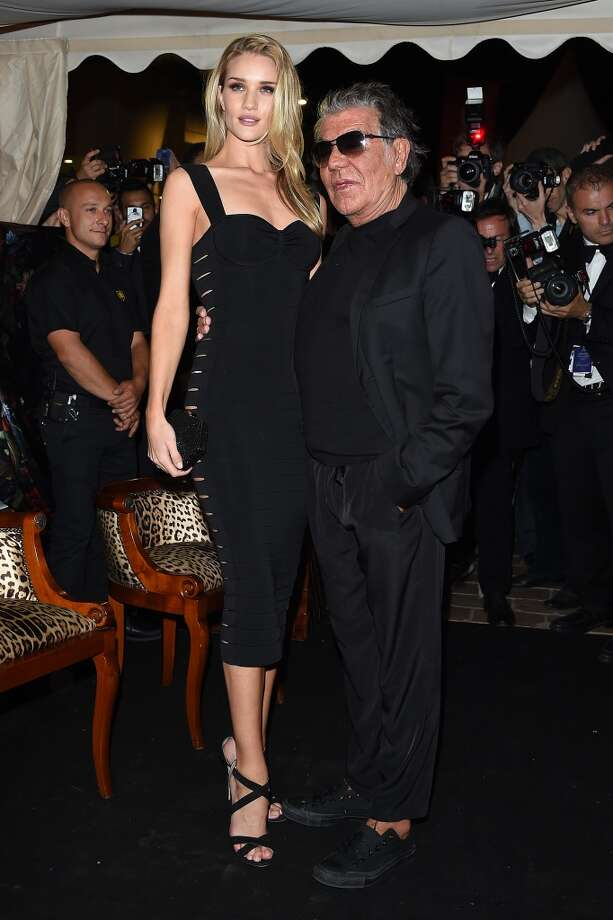 "Rosie Huntington-Whiteley and Roberto Cavalli attend the ""Roberto Cavalli Annual Party Aboard"" : Outside Arrivals at the 67th Annual Cannes Film Festival on May 21, 2014 in Cannes, France. Photo: Jacopo Raule, FilmMagic"