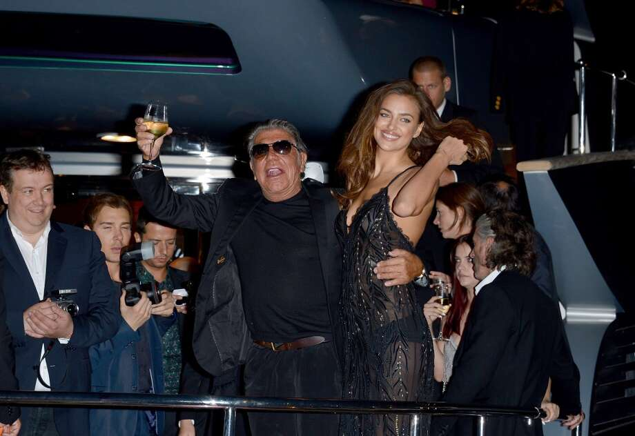 Roberto Cavalli and Irina Shayk attend the Roberto Cavalli yacht party at the 67th Annual Cannes Film Festival on May 21, 2014 in Cannes, France. Photo: Luca Teuchmann, Getty Images