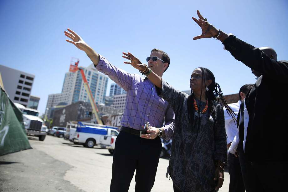 Developer Mike Ghielmetti (left) views construction with Konda Mason and Ashara Ekundayo of Impact Hub Oakland. Photo: Lea Suzuki, The Chronicle