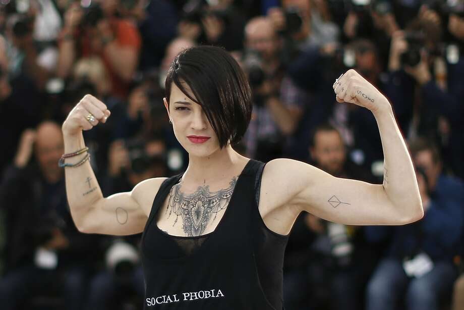 "Film buff: Italian actress and director Asia Argento flexes for the crowd during a photo call for the movie ""Incompresa (Misunderstood)"" at Cannes. Photo: Valery Hache, AFP/Getty Images"