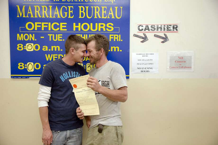 William Roletter (left) and Paul Rowe celebrate receiving their marriage certificate in Philadelphia after Pennsylvania's governor dropped his opposition to same-sex marriage. Photo: Matt Rourke, Associated Press