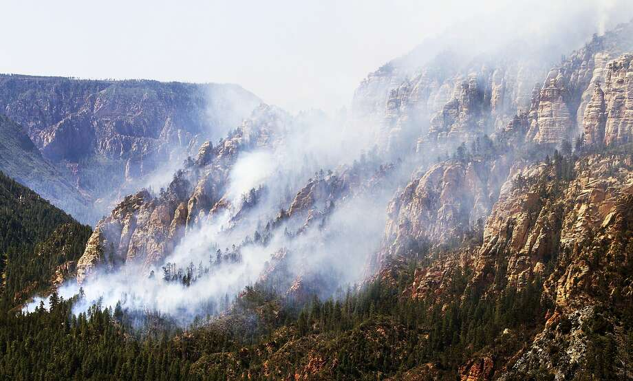 A wildfire dubbed the Slide Fire burns in scenic Oak Creek Canyon south of Flagstaff, Ariz. The blaze forced evacuations in several nearby communities. Photo: Tom Tingle, Associated Press