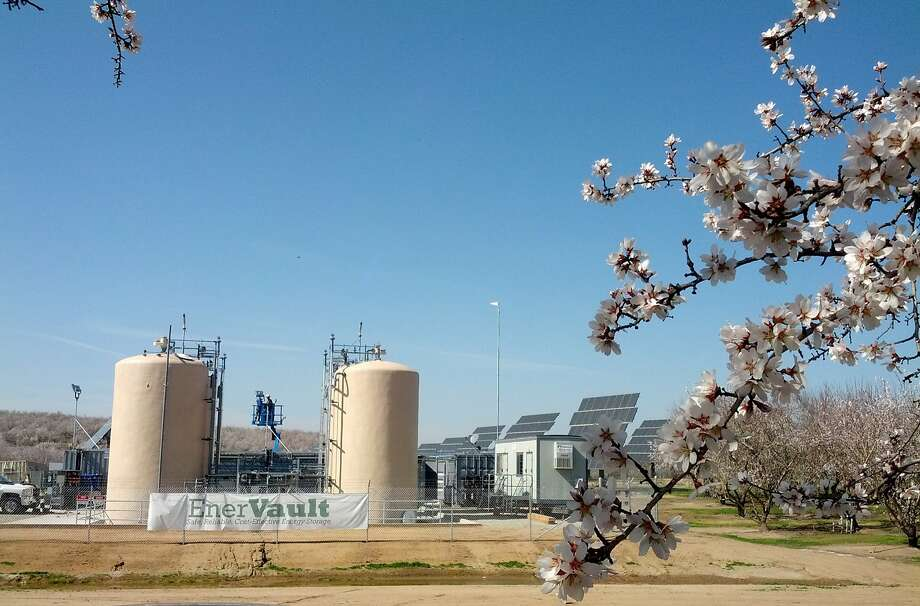The EnerVault flow battery's two electrolyte tanks store energy generated by a solar array in an almond orchard outside Turlock (Stanislaus County). Photo: Courtesy EnerVault