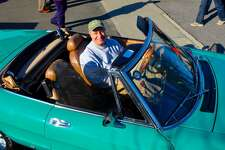 Thomas Cappo in his 1982 Alfa Romeo Spider Veloce, at the Caffeine and Carburetors Car Show at Zumbach's,  which lined both Pine Street and Elm Street, on Sunday, April 6, 2014, in New Canaan, Conn.