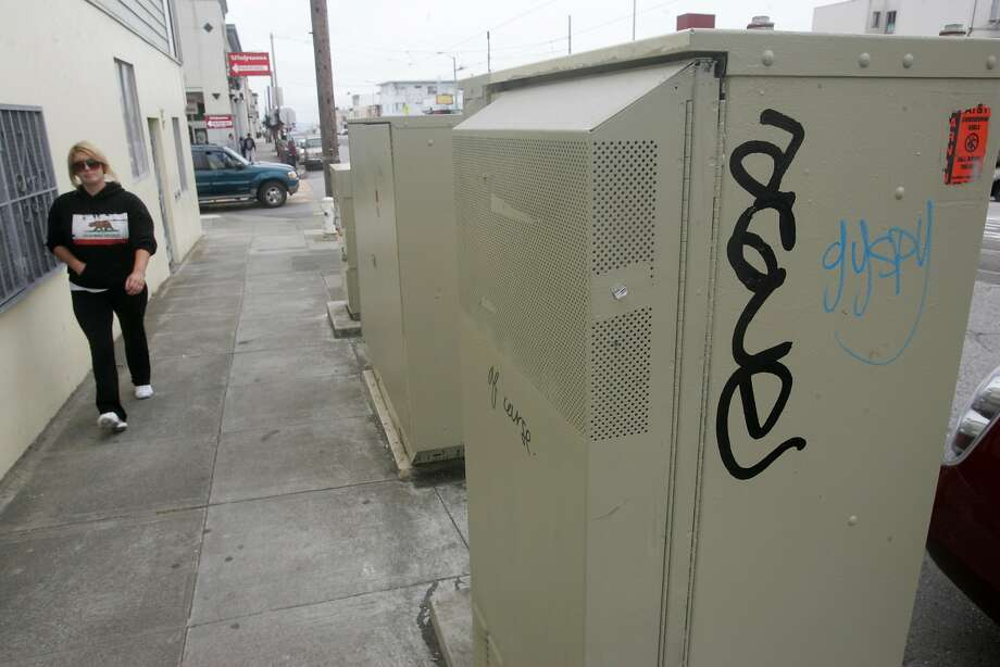 A line of utility boxes lines Taraval St. at 40th Ave. in the Sunset. Photo: Mathew Sumner, Special To The Chronicle