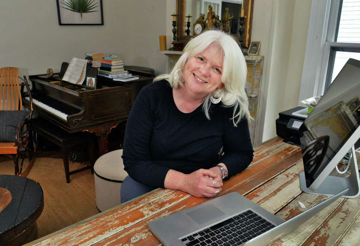 Patricia Lane in the parlor office of her 1880s Italianate townhouse on Spring Street Friday May 16, 2014, in Saratoga Springs, NY. (John Carl D'Annibale / Times Union)