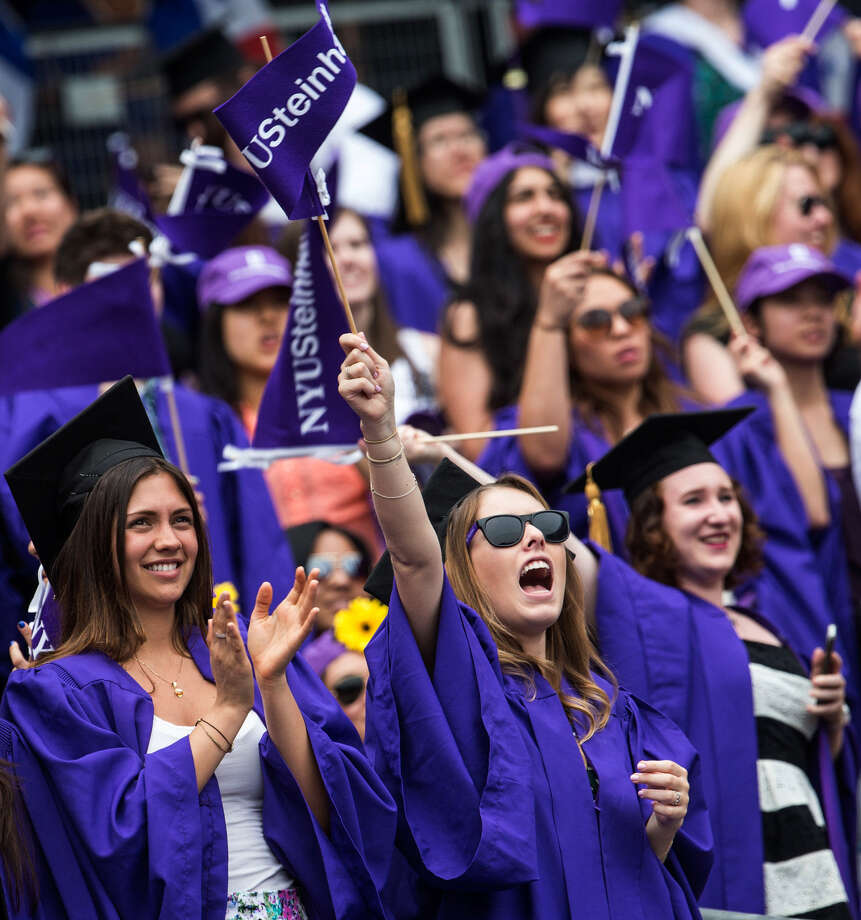 Students celebrate at the 2014 New York University commencement at Yankee Stadium. Such ceremonies should be about students' accomplishments, not controversial speakers. Photo: Andrew Burton, Getty Images / 2014 Getty Images