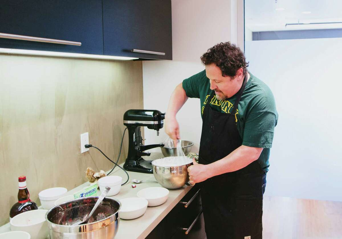 """Jon Favreau whips up lunch in his office at Venice Beach in Los Angeles, April 16, 2014. Favreau, an actor and filmmaker, prepared the meal with skills left over from his new movie, """"Chef,"""" a small film he is serving up between blockbusters. (David Walter Banks/The New York Times) -- PHOTO MOVED IN ADVANCE AND NOT FOR USE - ONLINE OR IN PRINT - BEFORE APRIL 27, 2014. ORG XMIT: XNYT121"""