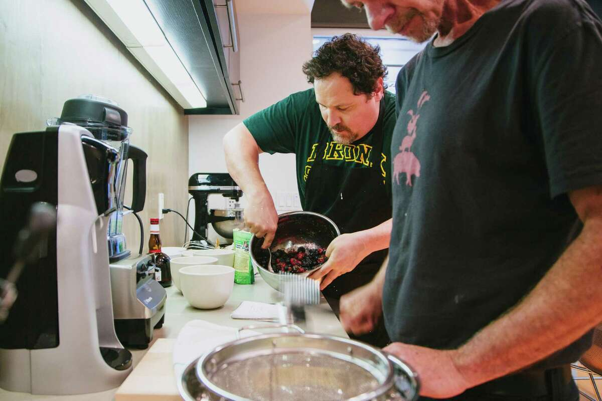 """Jon Favreau, left, whips up lunch in his office at Venice Beach in Los Angeles, April 16, 2014. Favreau, an actor and filmmaker, prepared the meal with skills left over from his new movie, """"Chef,"""" a small film he is serving up between blockbusters. (David Walter Banks/The New York Times) -- PHOTO MOVED IN ADVANCE AND NOT FOR USE - ONLINE OR IN PRINT - BEFORE APRIL 27, 2014. ORG XMIT: XNYT120"""