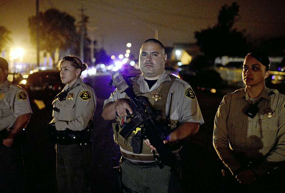 Police patrol Wednesday in Salinas, where protesters turned against officers responding to a shooting. Demonstrators were angry over three officer-involved fatal shootings this year. Photo: Nic Coury, Associated Press