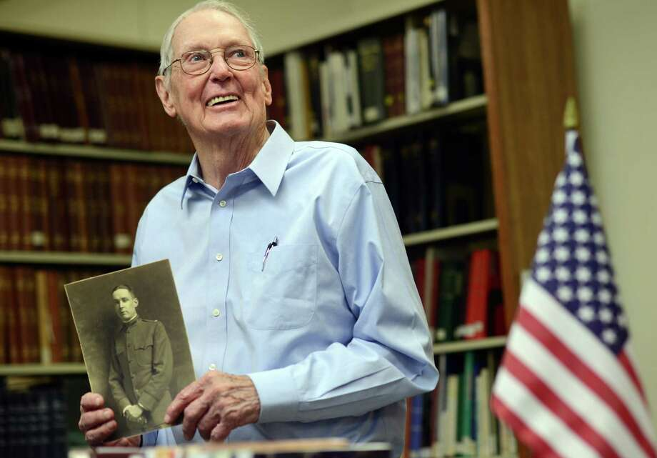 Vincent Radel Keating, of Fairfield, holds a photo of his father Vincent Leo Keating, who served in WWI, Thursday, May 22, 2014, at the History Center in the Burroughs-Saden Library in Bridgeport, Conn. Keating has donated items from his father, including a diary kept during the war and photos, for a World War I exhibit at the library. Photo: Autumn Driscoll / Connecticut Post