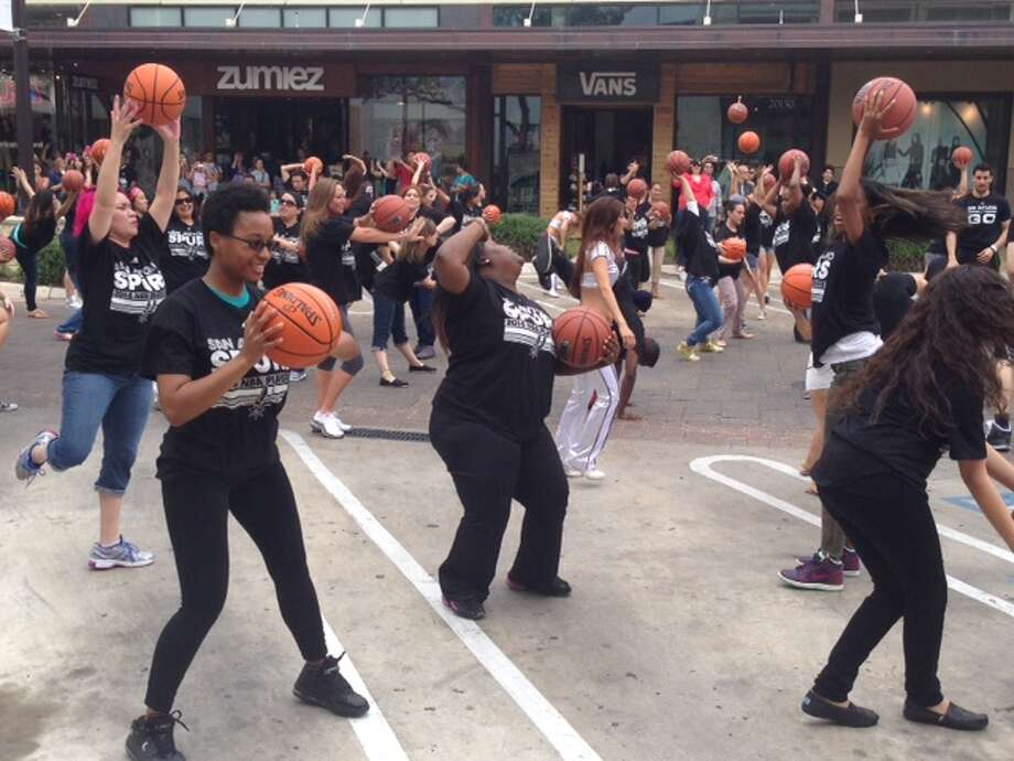 "Dancers groove to Coldplay's ""Sky Full of Stars"" in a flash mob titled, ""For the Love of Basketball"" Thursday. Photo: Rebecca Salinas/Express-News"