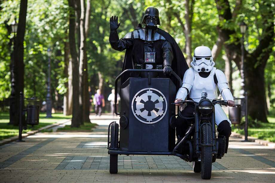 "The TIE fighter was in the shop: ""Darth Vader,"" Internet Party mayoral candidate in Kiev, arrives by chauffeured chariot to speak to the media on the city's Volodymyrska Hill. Among other pledges, Vader promised ""fish for everyone"" and ""anti-gravity tripods for journalists."" Photo: Dan Kitwood, Getty Images"