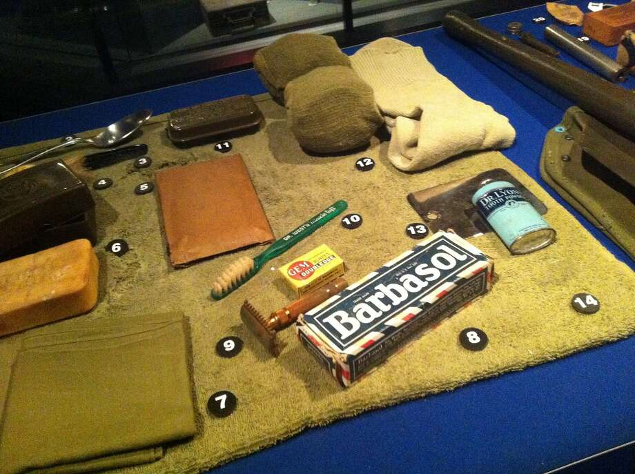 A display at the National WWII Museum in New Orleans includes items that were issued to soldiers who were bound for France, from cigarettes to shaving kit, but oddly doesn't include the tin of condoms. Photo: Spud Hilton, The Chronicle