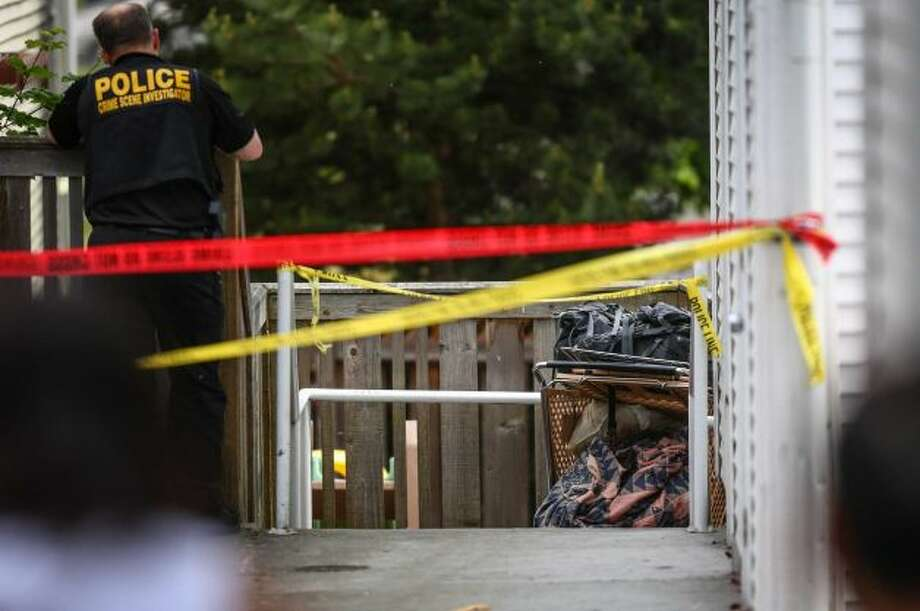 Police found a body wrapped in a shopping cart in a residential neighborhood in Othello Thursday morning. Investigators are now looking for a man who reportedly was pushing the cart in the neighborhood earlier that day. Photo: Joshua Trujillo, Seattlepi.com