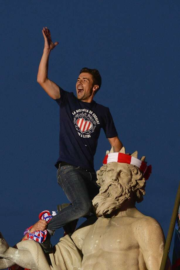 Gabi celebrates Atletico Madrid's La Liga title with a statue of Neptune on Sunday. Is a Champions League crown next? Photo: Pedro Armestre, AFP/Getty Images