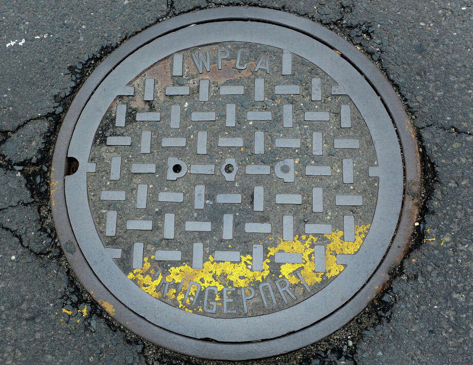 A manhole cover in Bridgeport, Conn., May 22, 2014. Photo: Ned Gerard / Connecticut Post