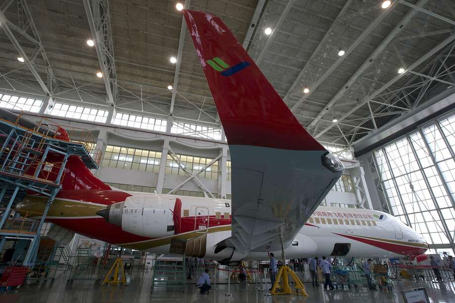 China's Comac set to deliver first passenger jets