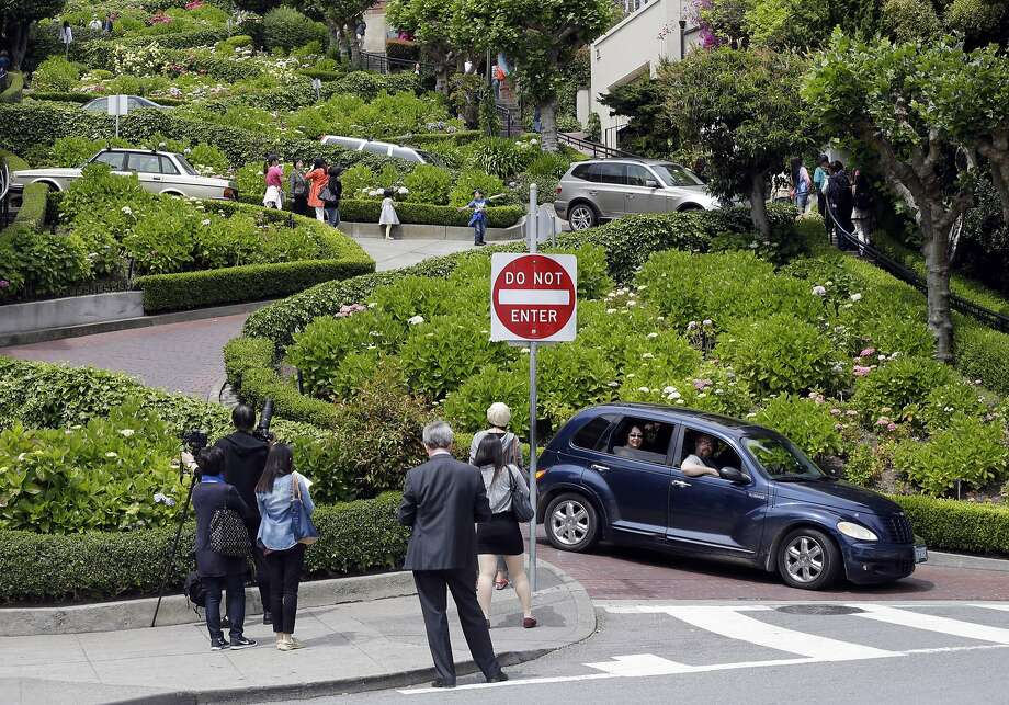 Motorists and visitors on foot converged on Lombard Street last week. Photo: Marcio Jose Sanchez, Associated Press