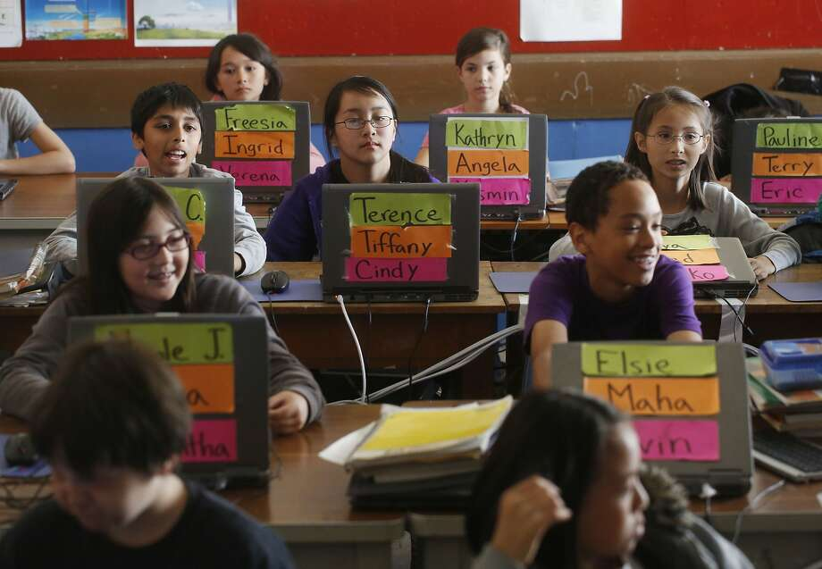 Special-needs students and those without disabilities learn together in a sixth-grade class at Presidio Middle School in S.F. Photo: Mike Kepka, The Chronicle