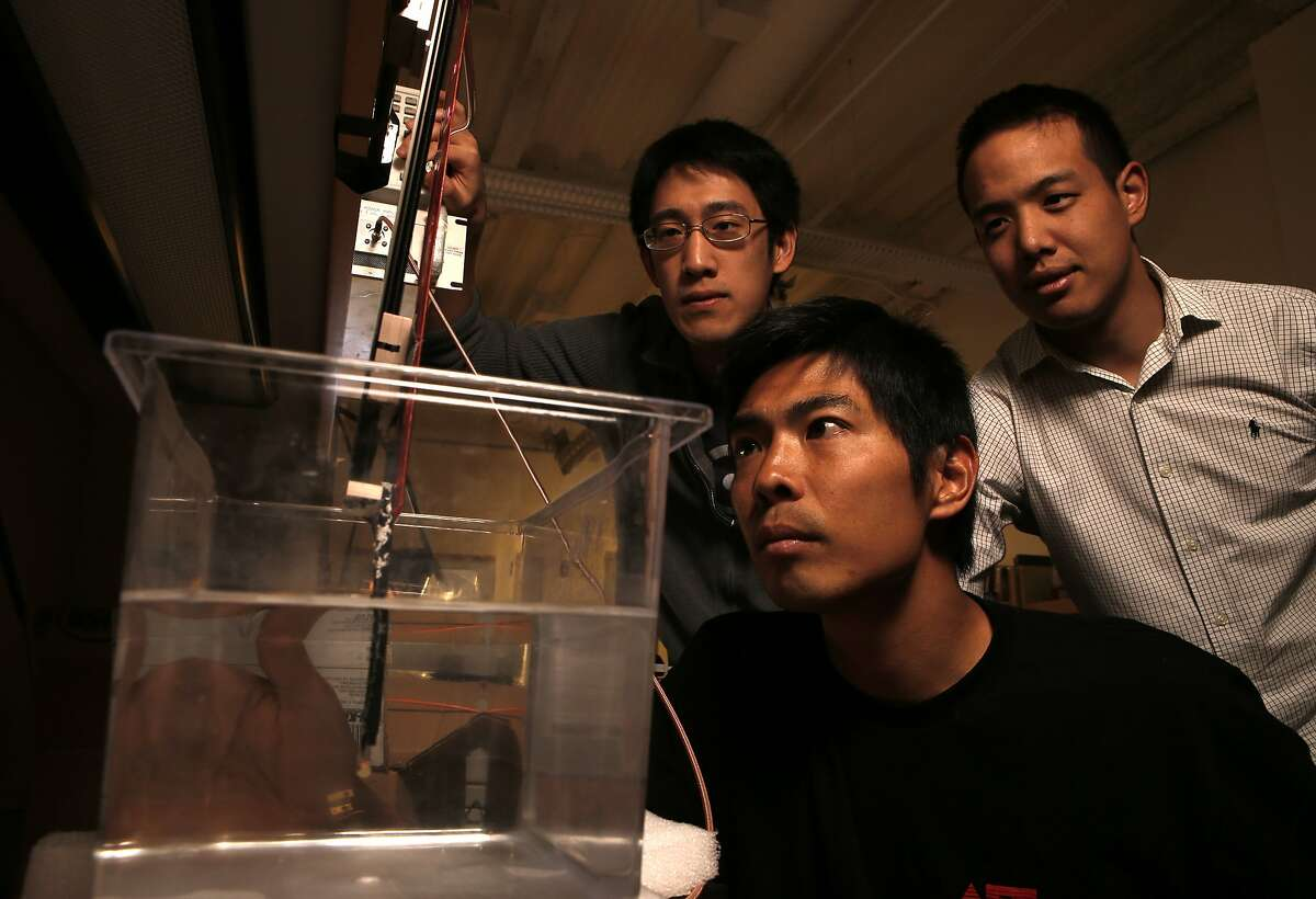 Research team members, (l to r) John Ho, co-first author and graduate student, Yugi Tanabe, visiting scholar and Alex Yeh, co-first author and graduate student, had to build their own test equipment including this optical power measurement device to test power efficiency, at their research laboratory on the Stanford campus, in Palo Alto, Calif., on Wednesday May 21, 2014. Stanford electrical engineer, Professor Ada Poon, has invented a way to wirelessly transfer power deep inside the body, and then use this power to run tiny electronic medical gadgets such as pacemakers, nerve stimulators or new sensors/devices yet to be developed.