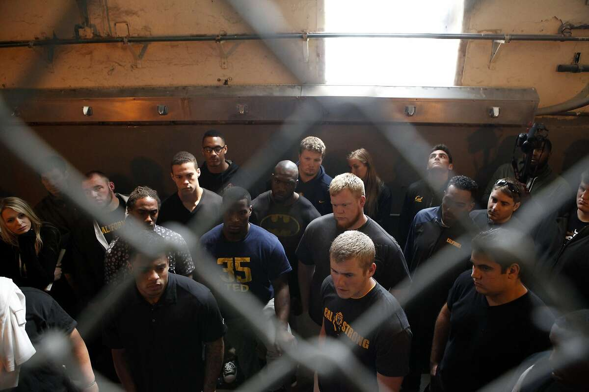 Cal Bears football players are seen in the shower area of an inmate housing block as the team makes a visit to San Quentin State Prison in San Quentin, CA, Saturday May 3, 2014.