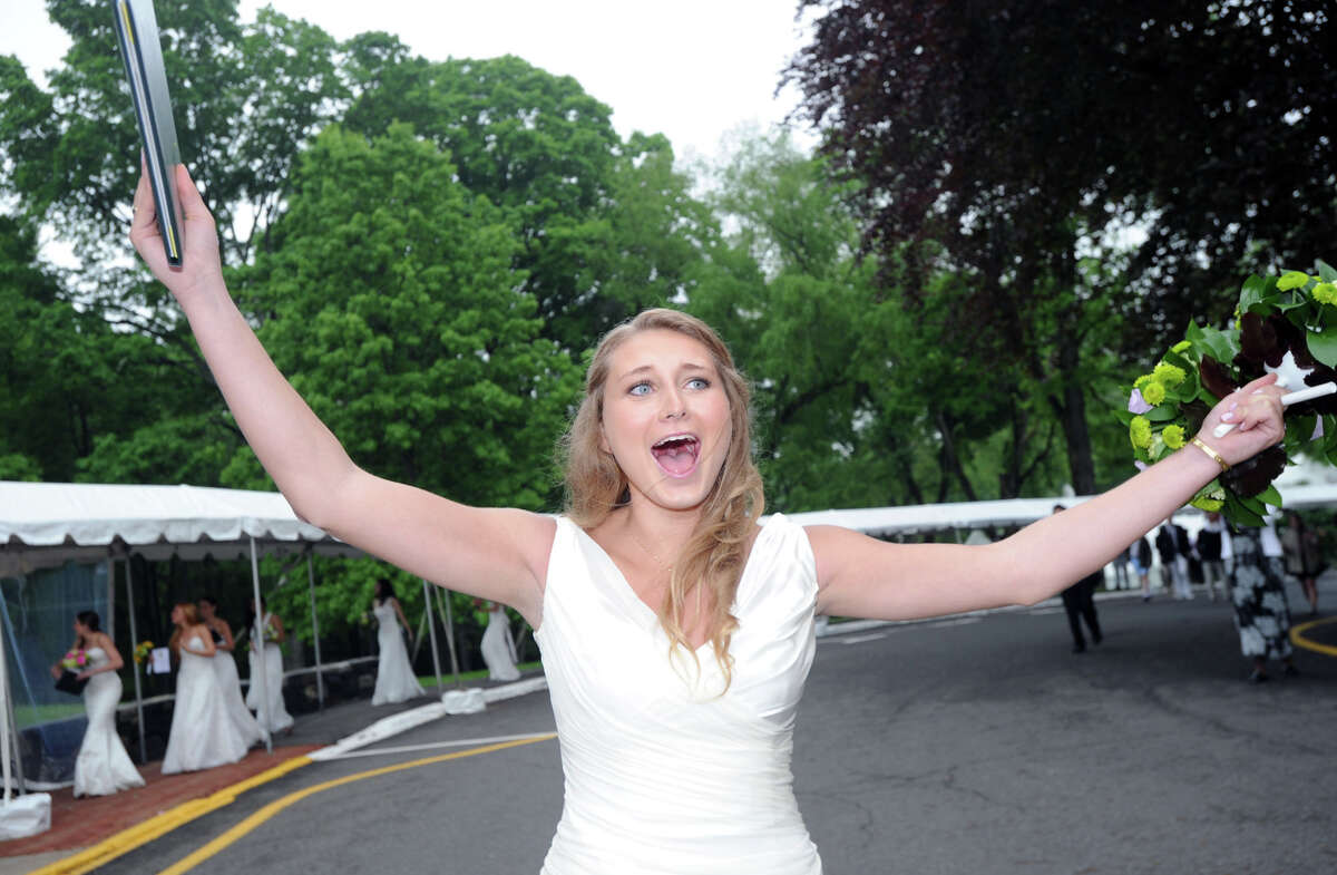 Greenwich Academy Graduate, Christina Womble, 18, of Greenwich, reacts at the conclusion of her graduation ceremony at Greenwich Academy in Greenwich, Conn., Thursday, May 22, 2014.