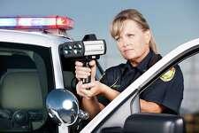 Traffic Enforcement: Woman Police Officer with Laser Gun