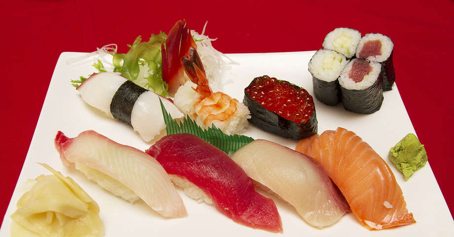 The Sushi Mix (clockwise from top): Octopus, shrimp, salmon roe, cucumber roll, tuna roll, smoked salmon, yellowtail, tuna, snapper. Photo: Photos By Alma E. Hernandez / For The Express-News