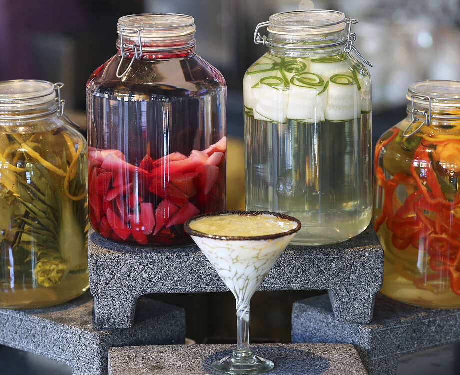 Various fruits, peppers and veggies are displayed on the bar at The Frutería. More bartenders and mixologists are using fresh ingredients in cocktails. Photo: Tom Reel / San Antonio Express-News