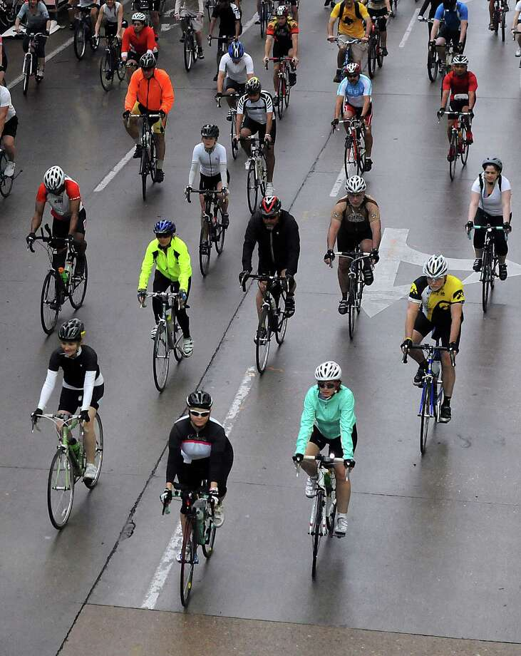 Cyclists ride in the annual Tour de Houston bike ride downtown Sunday  March 16, 2014.(Dave Rossman photo) Photo: Dave Rossman, Freelance / Freelance