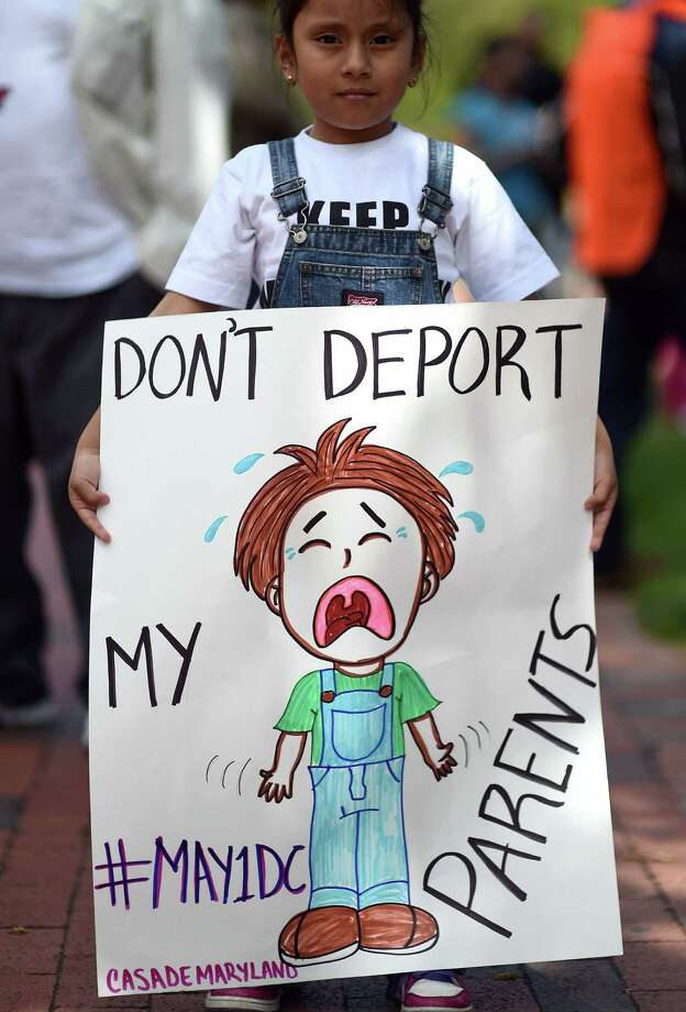 A child displays a placard during a demonstration near the White House in Washington, DC, on May 1, 2014 to protest against deportations of undocumented people. Hundreds of people, including children, joined in the protest against US President Barack Obamas immigration enforcement, calling on him to stop most deportations. AFP PHOTO/Jewel SamadJEWEL SAMAD/AFP/Getty Images Photo: JEWEL SAMAD, Staff / AFP