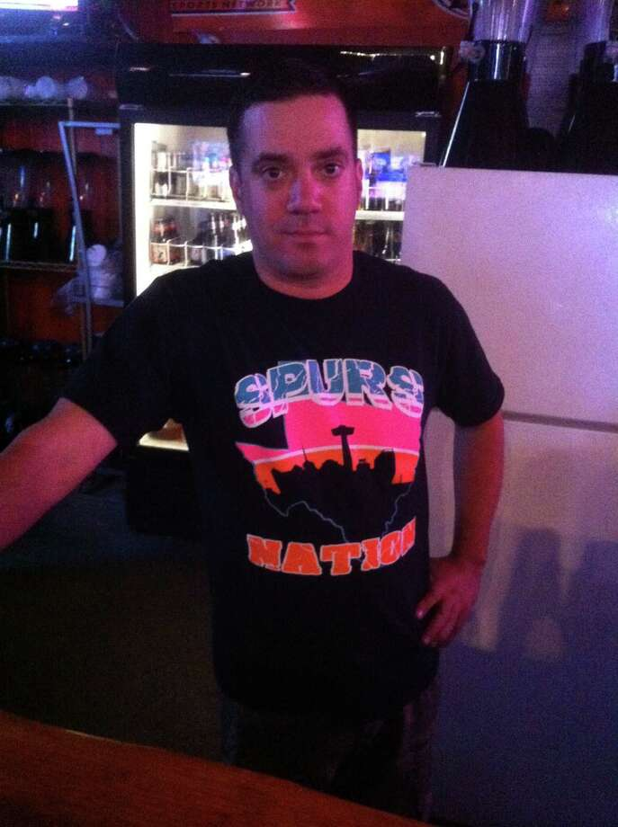 Jake Galvan, bartender at FatsoÕs Sports Garden. Galvan got his shirt with retro Fiesta colors and a modern interpretation of the logo from a vendor outside the bar. He said he has noticed a lot of the younger crowd wearing the old logo. Photo: Breanna Kerr